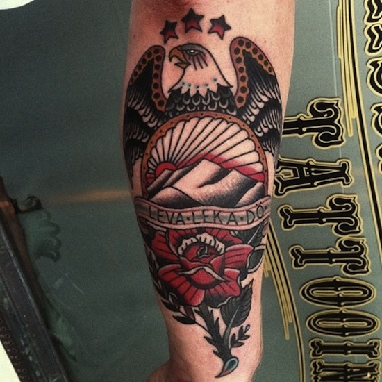 Red Flower And Traditional Eagle Tattoo On Forearm