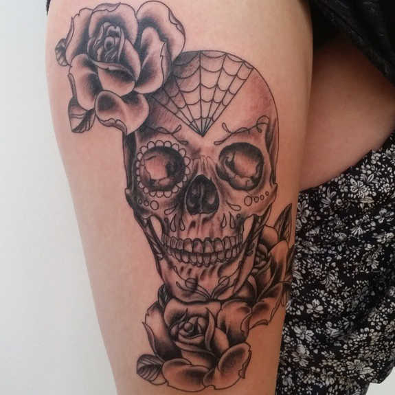 Rose Flowers And Sugar Skull Tattoo On Thigh