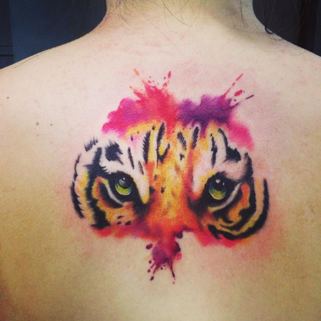 Tiger Eyes Tattoo On Upper Back With Watercolors