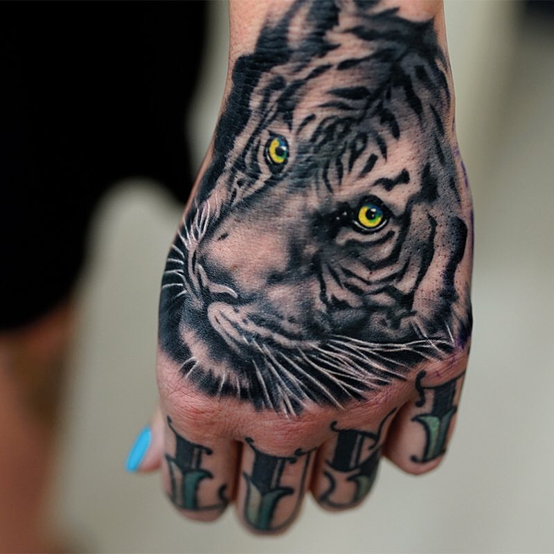 White Tiger Head With Yellow Eyes Tattoo On Left Hand