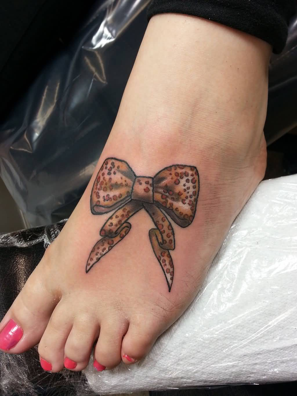 amazing leopard print bow tattoo on girl left foot rh askideas com leopard print bow tattoo designs Colorful Leopard Print Tattoos