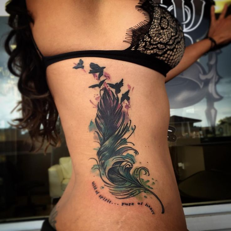 046327780 Birds Flying From Feather Tattooed On Girl Rib Side