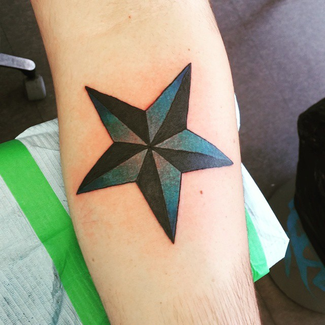 9c1f12ab96f1e Black And Blue Ink Nautical Star Tattoo On Forearm