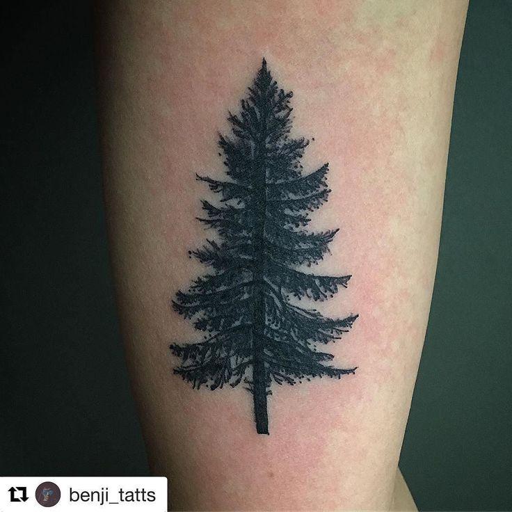 Black ink pine tree tattoo on bicep for Pine tree tattoo ideas