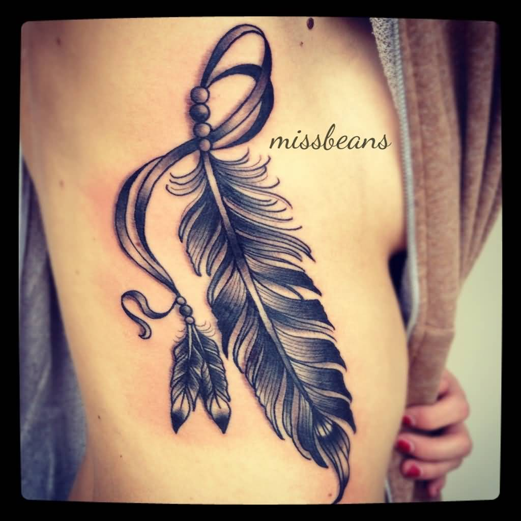 Black And Grey Feather Tattoo On Girl Rib Side