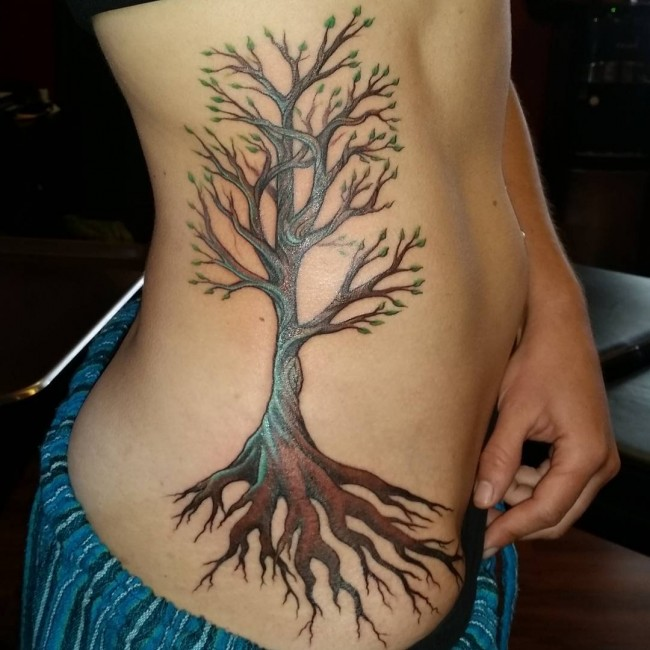Brown and green ink birch tree tattoo on side rib for Birch tree tattoo meaning