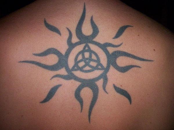 Celtic Knot In Tribal Sun Tattoo On Upper Back