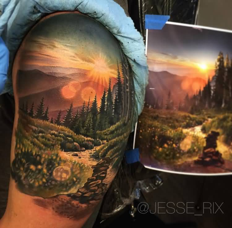 Colored Realistic Sun Tattoo On Left Shoulder by Jesse_RIX