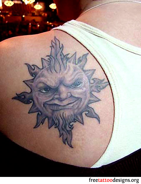 Evil realistic sun tattoo on left back shoulder for Realistic sun tattoo