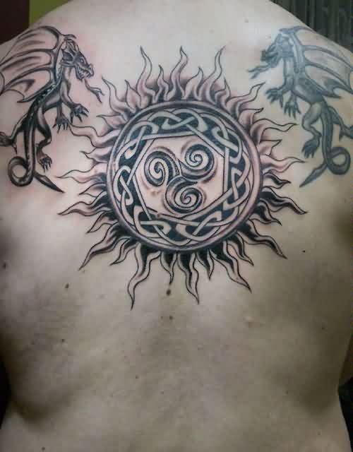 flying dragons and celtic sun tattoo on upper back. Black Bedroom Furniture Sets. Home Design Ideas