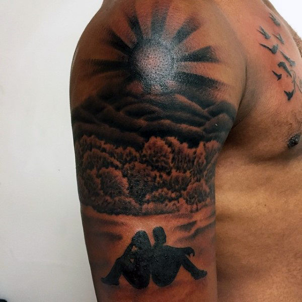 Grey And Black Ink Rising Sun Tattoo On Man Shoulder