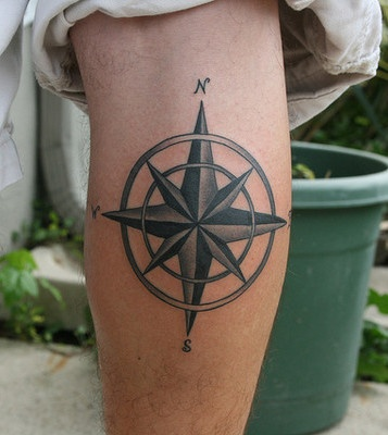 Grey and black nautical star tattoo on leg for Star tattoos on leg