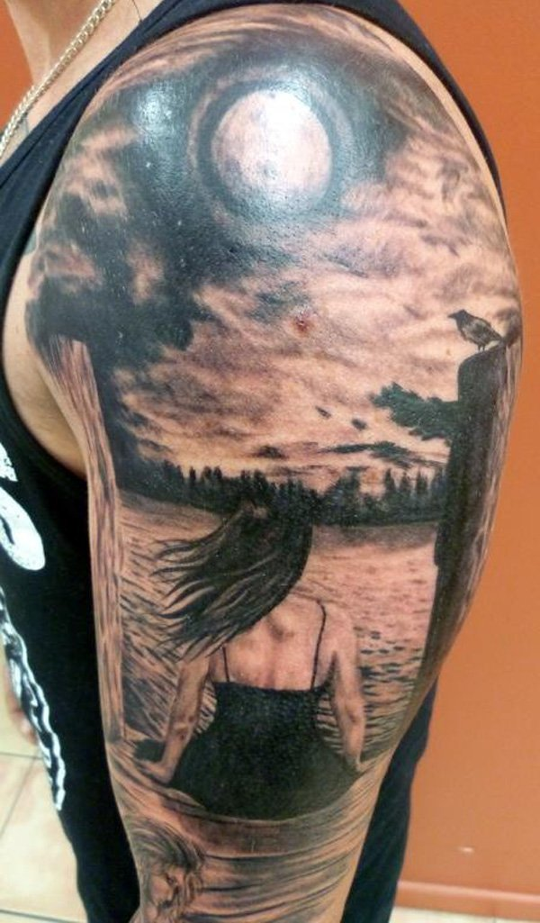 Grey And Black Realistic Beach View And Sun Tattoo On Man Left Shoulder