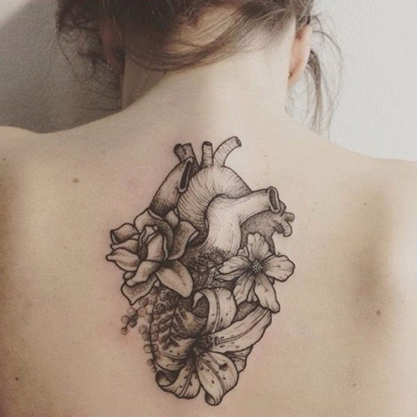 Grey Flowers And Human Heart Tattoo On Upper Back