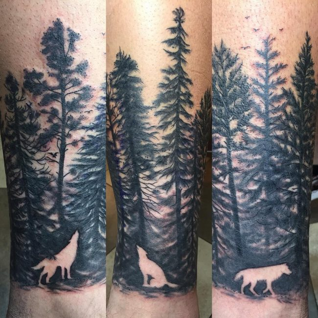 Howling Wols And Pine Tree Tattoo On Arm