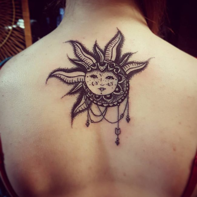 Jewels Hanging On Sun Tattoo On Upper Back