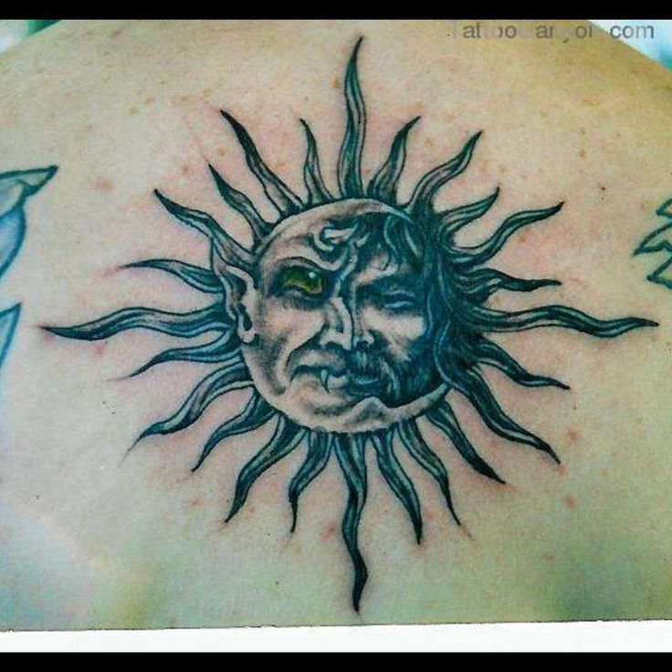 Old Sun Tattoo On Upper Back
