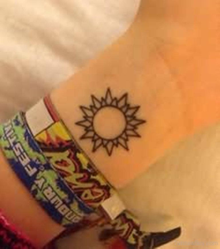Outline Simple Sun Tattoo On Girl Left Wrist