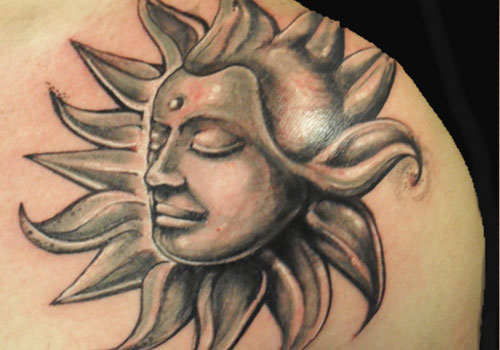 Realistic Face In Sun Tattoo On Shoulder