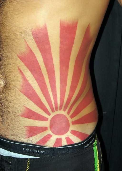 Red Ink Rising Sun Tattoo On Man Hip