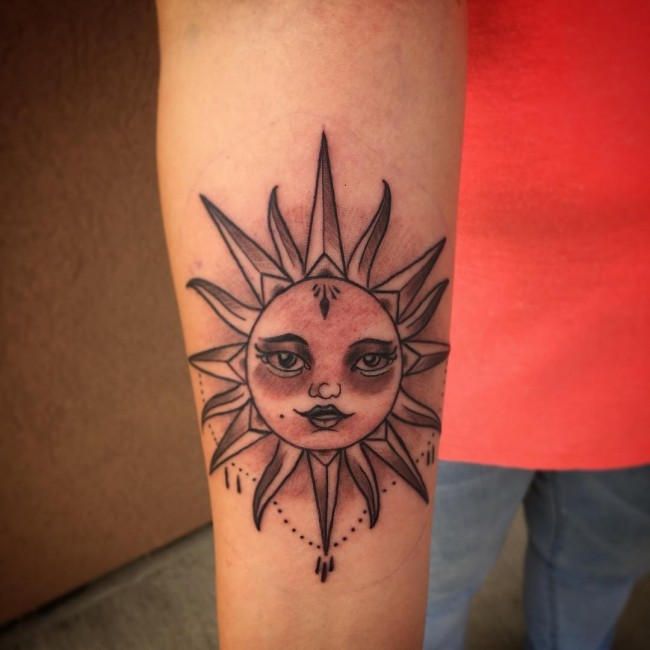 Small Grey Sun Tattoo On Right Forearm