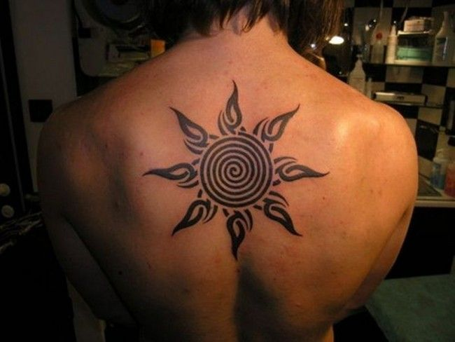 Spiral Sun With Tribal Rays Tattoo On Upper Back