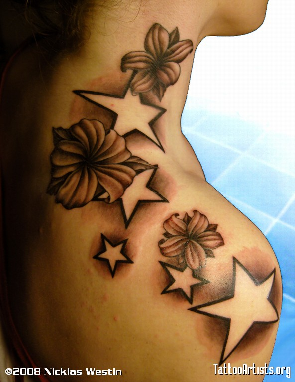 Stars And Lily Flower Tattoo On Right Upper Shoulder