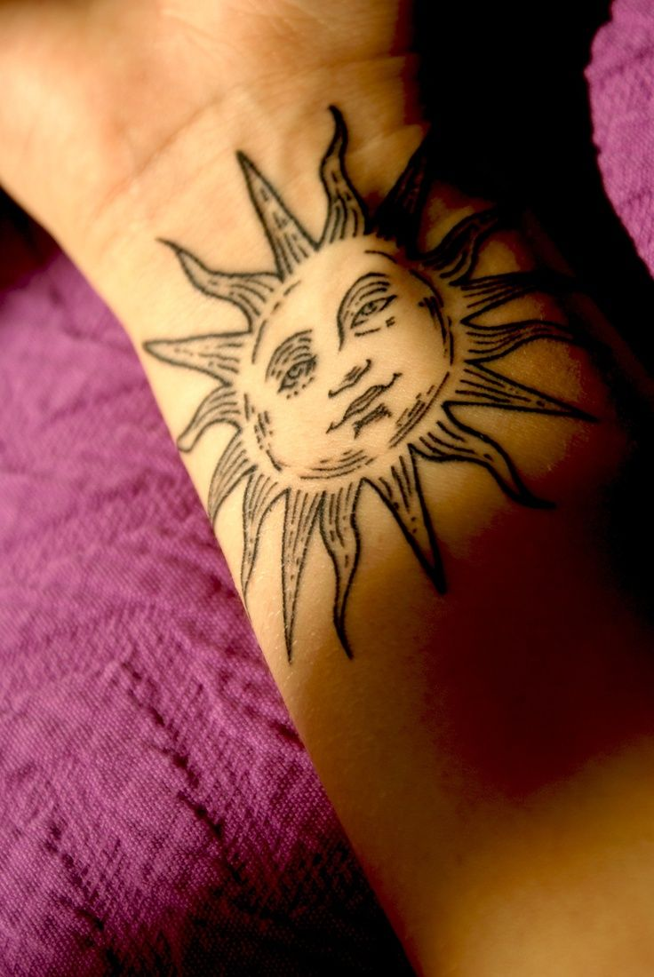 Sun Tattoo On Right Wrist
