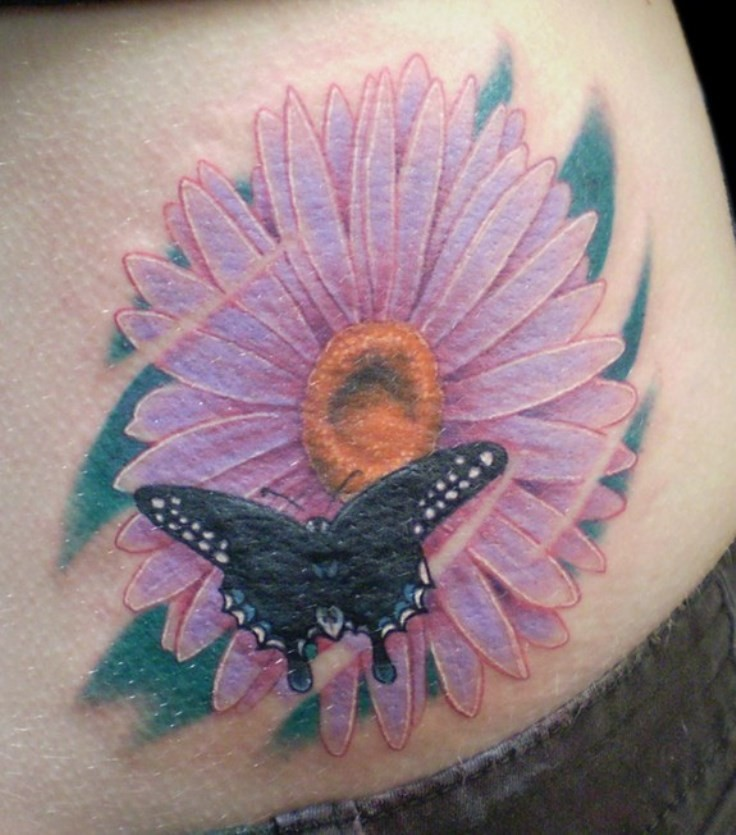Black Butterfly And Daisy Flower Tattoo On Lower Back