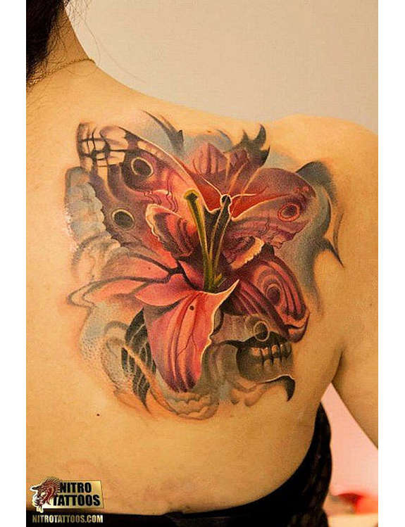 Butterfly And Lily Flower Tattoo On Girl Right Back Shoulder