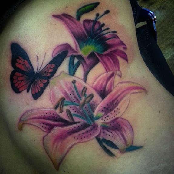 Butterfly And Lily Flowers Tattoo On Rib side