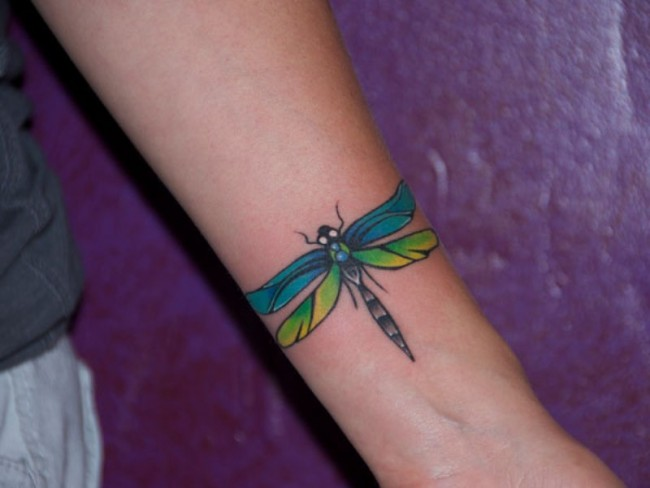 e85788eaad7f4 Colored Dragonfly Tattoo On Left Forearm