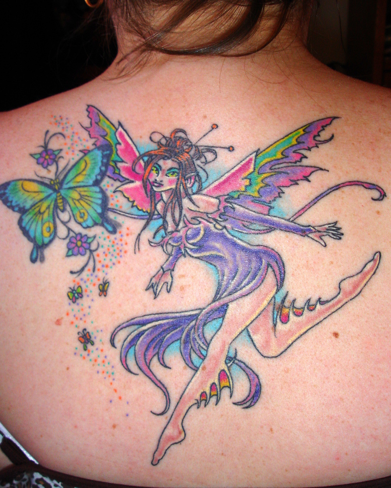 colorful flying fairy and butterfly with stars tattoo on girl upper back. Black Bedroom Furniture Sets. Home Design Ideas