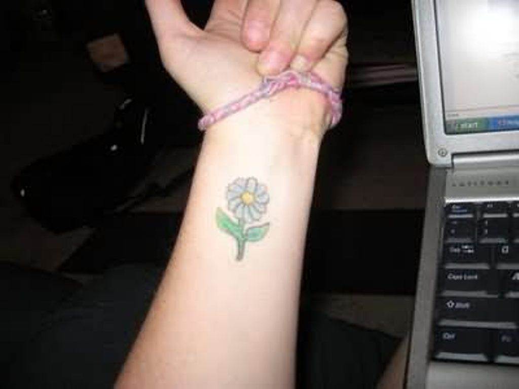 61 small daisy tattoos ideas with meaning girl with small daisy tattoos on left forearm izmirmasajfo