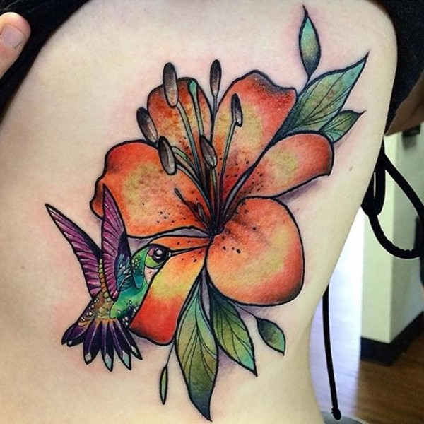 Hummingbird And Lily Flower Tattoo On Side Thigh