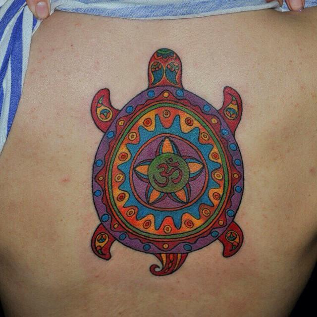 4dea843b87ff6 Om Symbol In Turtle Tattoo On Girl Side Rib