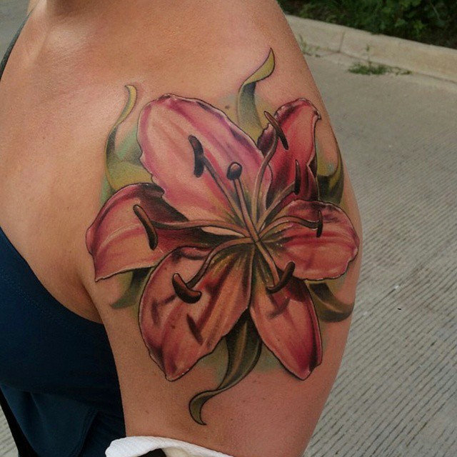 Pink Lily Flowers Tattoo On Left Shoulder