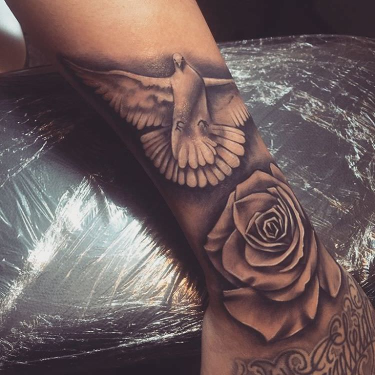 bb319a59f03d6 Realistic Rose And Dove Tattoo On Arm Sleeve