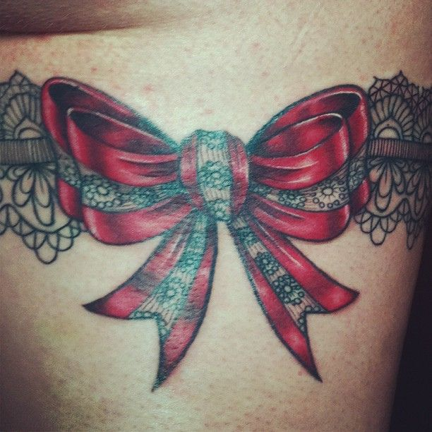 81 latest bow tattoos with meanings for Lace bow tattoo