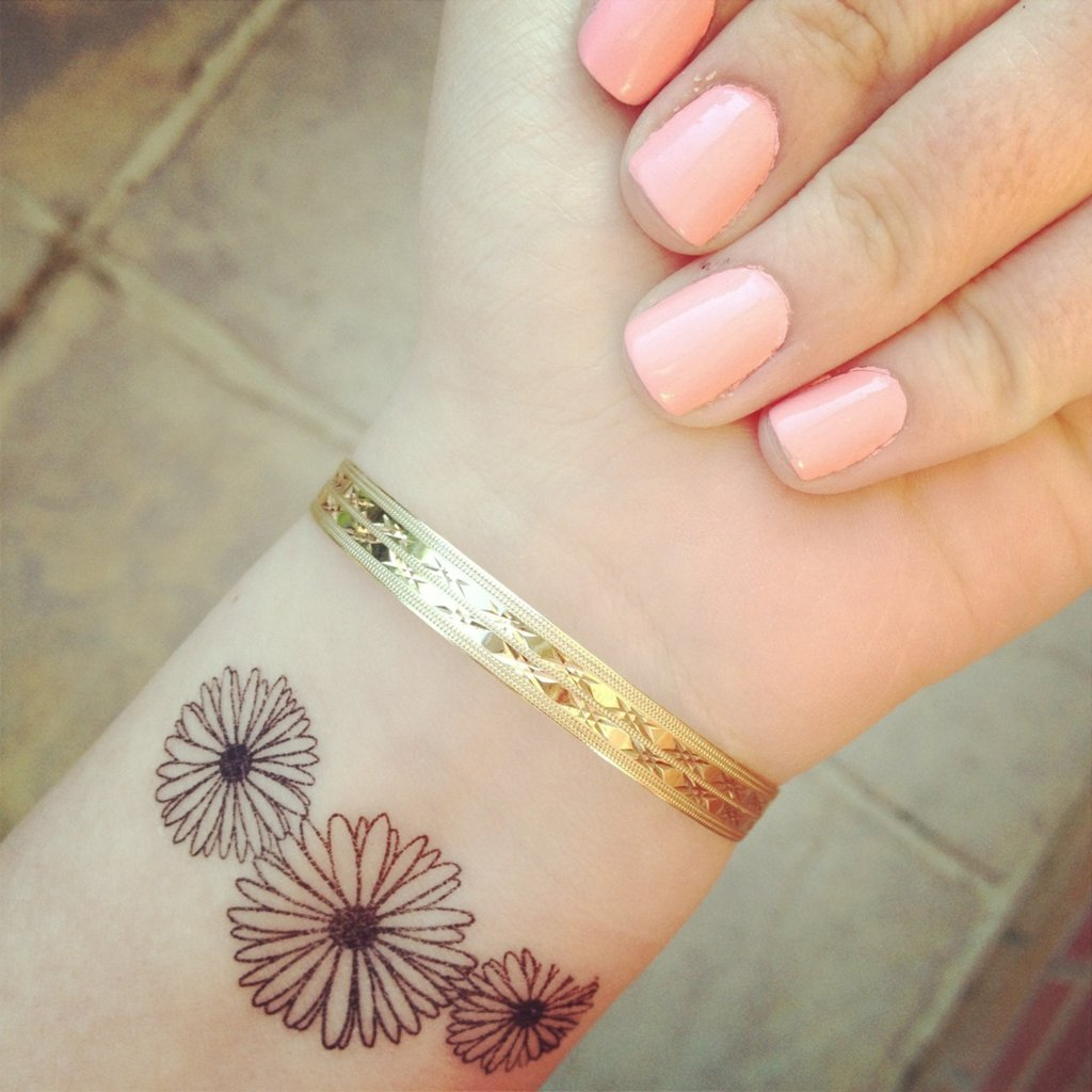 61 small daisy tattoos ideas with meaning three small daisy flowers tattoo on left wrist izmirmasajfo