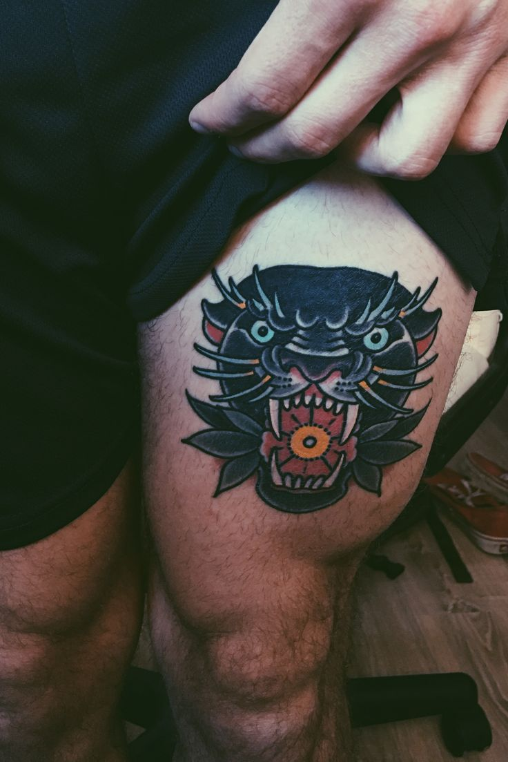 black panther tattoo with flowers