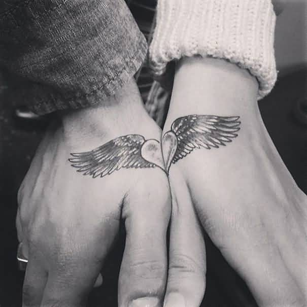 Angel Wings With Heart Tattoo On Hand