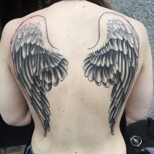 Beautiful angel wings tattoo on girls back for Angel wings girl tattoos