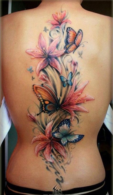 Beautiful butterfly tattoo with flowers for women on full back for Full back tattoos women