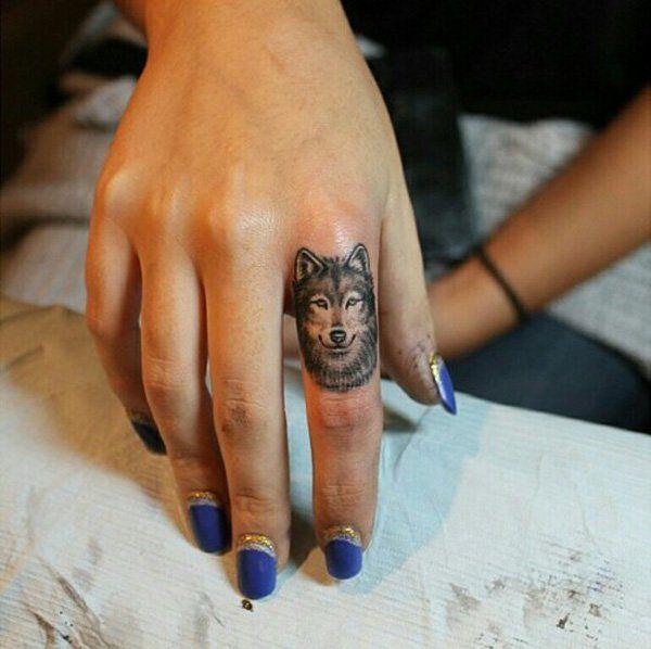 Beautiful Tiny Wolf Tattoo On finger