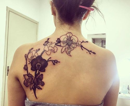 Black Fantastic Tribal Orchid Tattoo On back