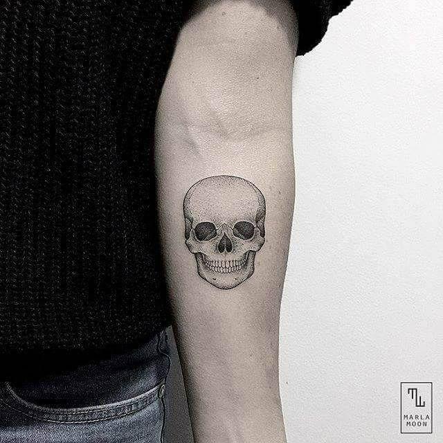 Black And Gray Skull Tattoo On Forearm