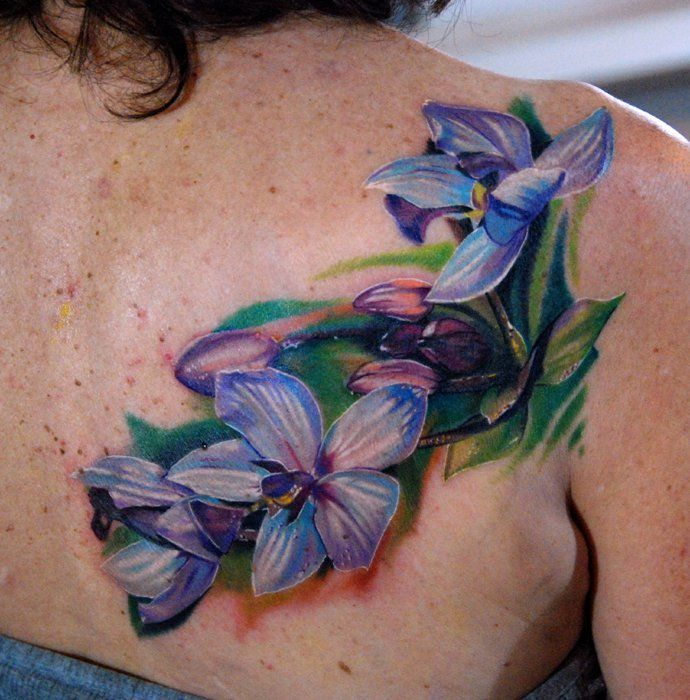 Blue Orchid Flower Tattoo On Back shoulder
