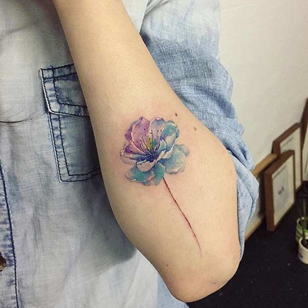 Blue Watercolor Cherry Blossom Tattoo On Elbow