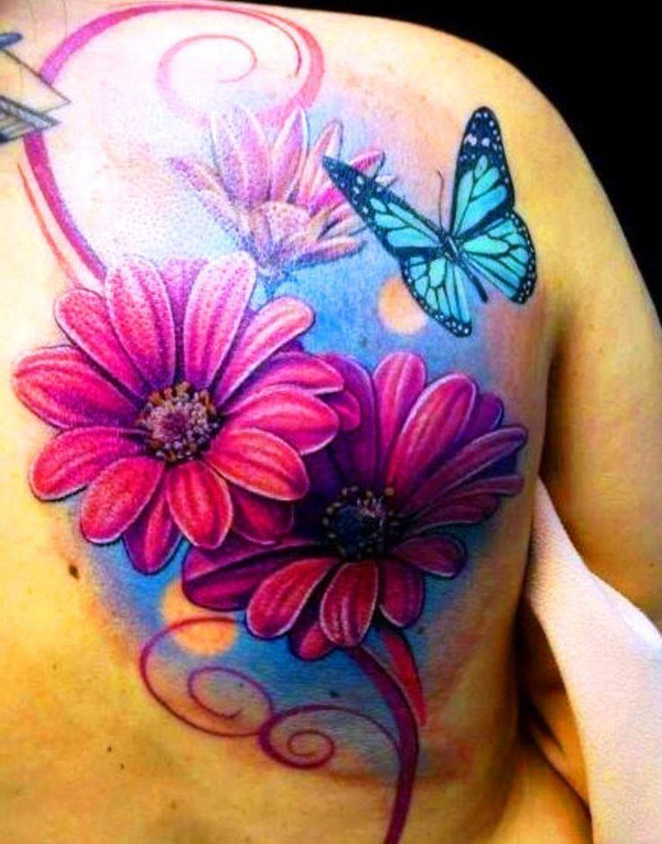 colorful flowers and blue butterfly tattoo on back